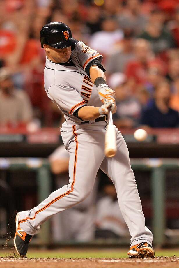 Juan Perez hits a two-run, go-ahead home run in the sixth inning against the Reds. Photo: Jamie Sabau, Getty Images