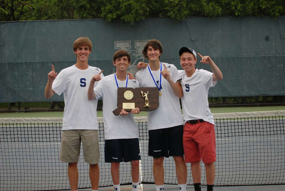 Members of the Staples boys team celebrate winning the Class LL championship on Wednesday. From left: Luke Foreman, Baxter Stein, Connor Mitnick and Jack Reardon. Photo: Picasa, Keith Stein/Contributed / Westport News Contributed