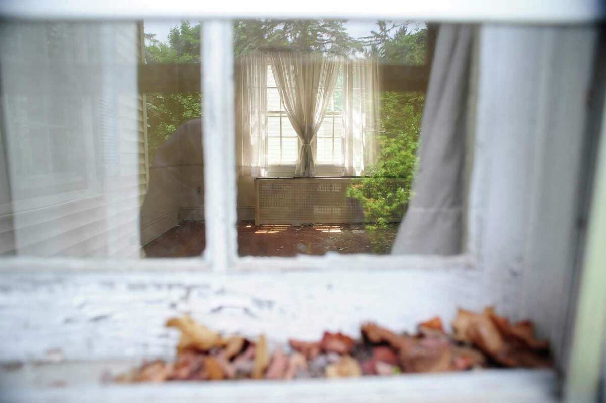 A view looking in through a window of an empty building at the corner of Balltown Road and Union Street on Wednesday, June 4, 2014, in Schenectady, N.Y. (Paul Buckowski / Times Union)