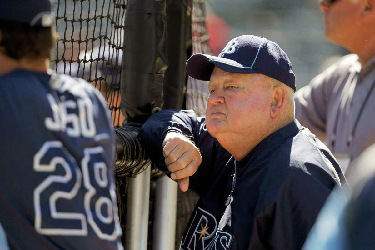 FILE - In this Sept. 30, 2011 file photo, former manager Don Zimmer watches the Tampa Bay Rays batting practice before Game 1 of baseball's American League division series playoffs against the Texas Rangers in Arlington, Texas. Don Zimmer, a popular fixture in professional baseball for 66 years as a manager, player, coach and executive, has died. He was 83. (AP Photo/Tony Gutierrez, File) ORG XMIT: ARL107
