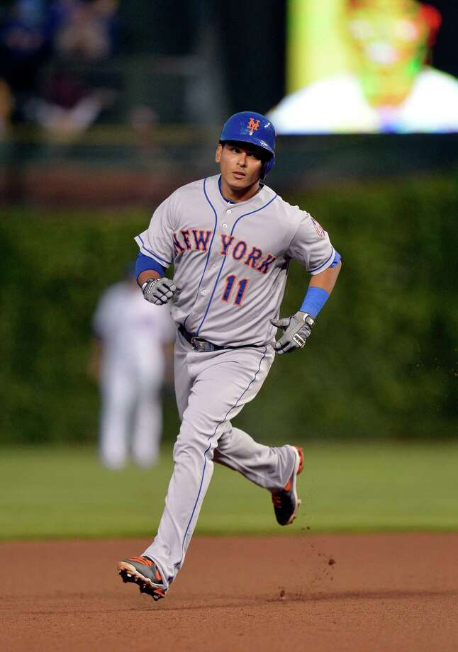 CHICAGO, IL - JUNE 4:  Ruben Tejada #11 of the New York Mets rounds the bases after hitting a solo home run during the fourth inning against the Chicago Cubs at Wrigley Field June 4, 2014 in Chicago, Illinois.  (Photo by Brian Kersey/Getty Images) ORG XMIT: 477584409 Photo: Brian Kersey / 2014 Getty Images
