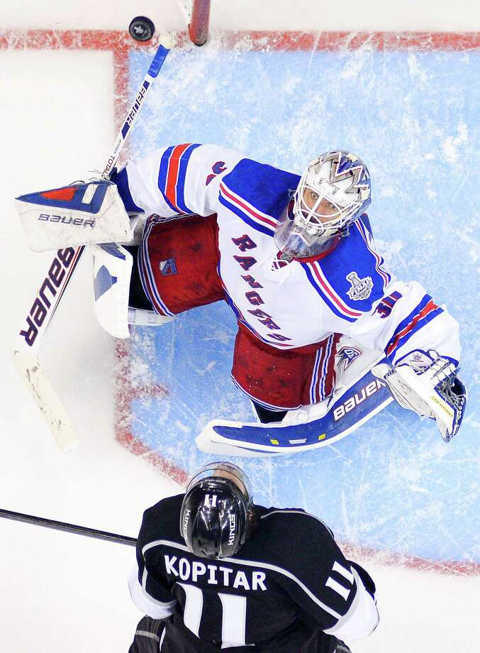 New York Rangers goalie Henrik Lundqvist, of Sweden, top, and Los Angeles Kings center Anze Kopitar, of Slovenia, the watches puck flip up in the during the third period in Game 1 of the NHL hockey Stanley Cup Finals, Wednesday, June 4, 2014, in Los Angeles. (AP Photo/Mark J. Terrill)  ORG XMIT: LAS125 Photo: Mark J. Terrill / AP