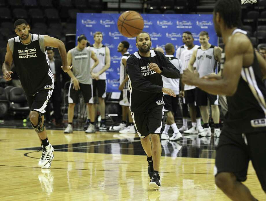 San Antonio's Tim Duncan (from left), Tony Parker and Kawhi Leonard get in some practice at the AT&T Center. Photo: Kin Man Hui / San Antonio Express-News / ©2014 San Antonio Express-News
