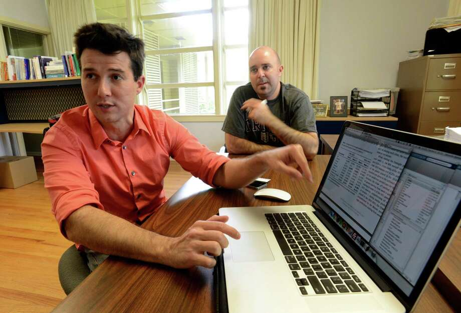 Dr. Eduardo Cabral Balreira, left, and Dr. Brian Miceli of Trinity University explain their mathematical model, called the Oracle method, which says that the Spurs will probably beat the Miami Heat in the NBA  Finals. June 3, 2014. Photo: San Antonio Express-News / San Antonio Express-News