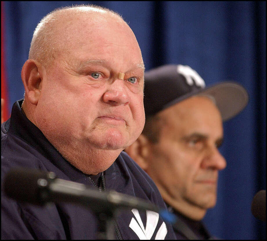 New York Yankees bench coach Don Zimmer talks to the media Sunday, Oct. 12, 2003, in Boston as Yankees manager Joe Torre listens in the background. A day after one of the nastiest games in the long-running Yankees-Red Sox feud, Zimmer apologized for his role in a melee that left him sprawled on the ground. He was fined, along with Pedro Martinez and Manny Ramirez of the Red Sox and Karim Garcia of the Yankees, the central players in the fights that interrupted New York's 4-3 win Saturday. (AP Photo/Boston Herald, Michael Seamans) Photo: MICHAEL SEAMANS, MBR / BOSTON HERALD