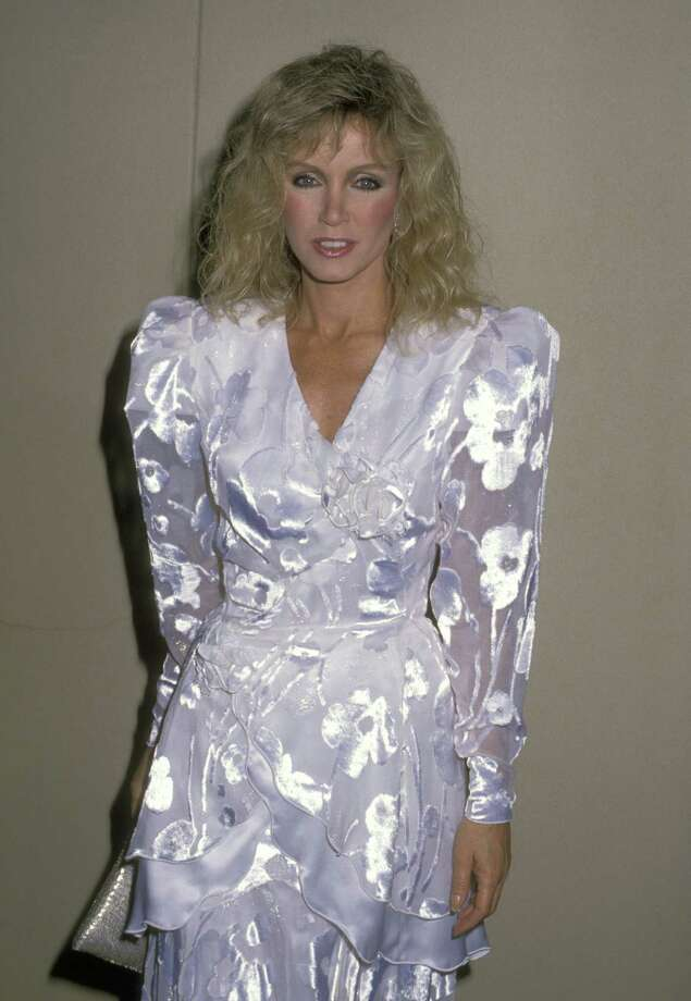 Fashion ran the gamut from neon to lace in the 80s, but every woman had a dress with pouffy sleeves by 1988. Photo: Ron Galella, WireImage Via Getty Images / Ron Galella Collection