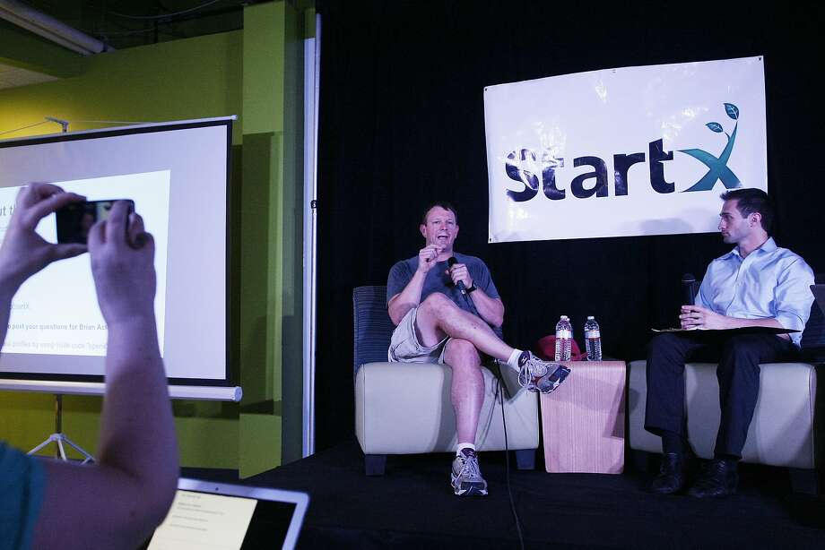 WhatsApp co-founder Brian Acton (left) speaks with Cameron Teitelman during a discussion in Palo Alto. Photo: James Tensuan, The Chronicle