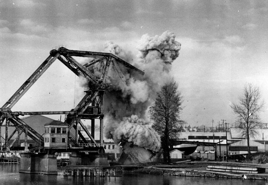 December 10, 1976- Ten pounds of plastic explosives put an end to the 61-year-old steel railroad drawbridge over Salmon Bay in the Lake Washington Ship Canal. Photo: FILE PHOTO, SEATTLEPI.COM / SEATTLEPI.COM