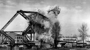 December 10, 1976 - Ten pounds of plastic explosives put an end to the 61-year-old steel railroad drawbridge over Salmon Bay in the Lake Washington Ship Canal.