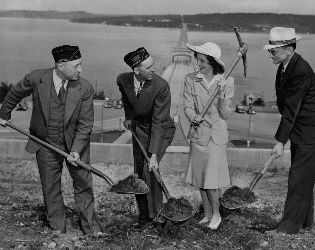 June 26, 1941 - Mayor Earl Millikin, left; Legionnaire Carl J. Hartwig; his daughter, Beverly Lee, and C.C. Arnold, bridge engineer, are shown breaking ground for erection of a flagpole over the west portal of the Lake Washington floating bridge.