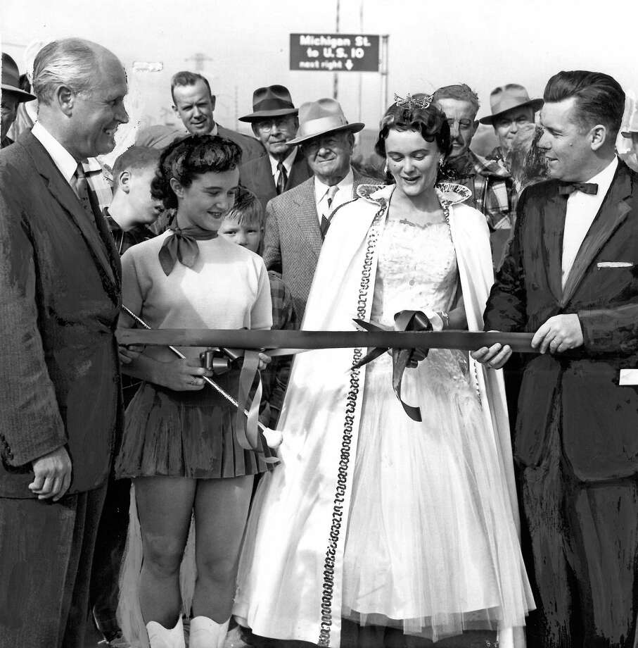 September 23, 1956- Gov. Arthur R. Langlie, left, and Mayor Gordon S. Clinton are shown here during the ribbon cutting at the opening of the new 1st Ave. S. Bridge. Photo by Tom Brownell. Photo: FILE PHOTO, SEATTLEPI.COM / SEATTLEPI.COM