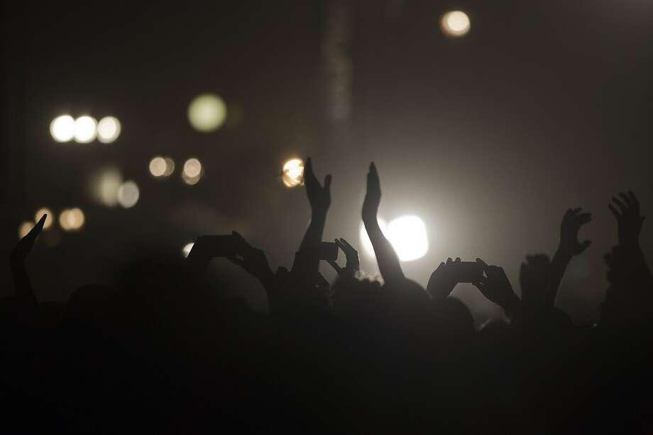 Spectators enjoy the Rolling Stones concert in Hayrkon Park in Tel Aviv, Israel, Wednesday, June 4, 2014. (AP Photo/Ariel Schalit) Photo: Ariel Schalit, Associated Press