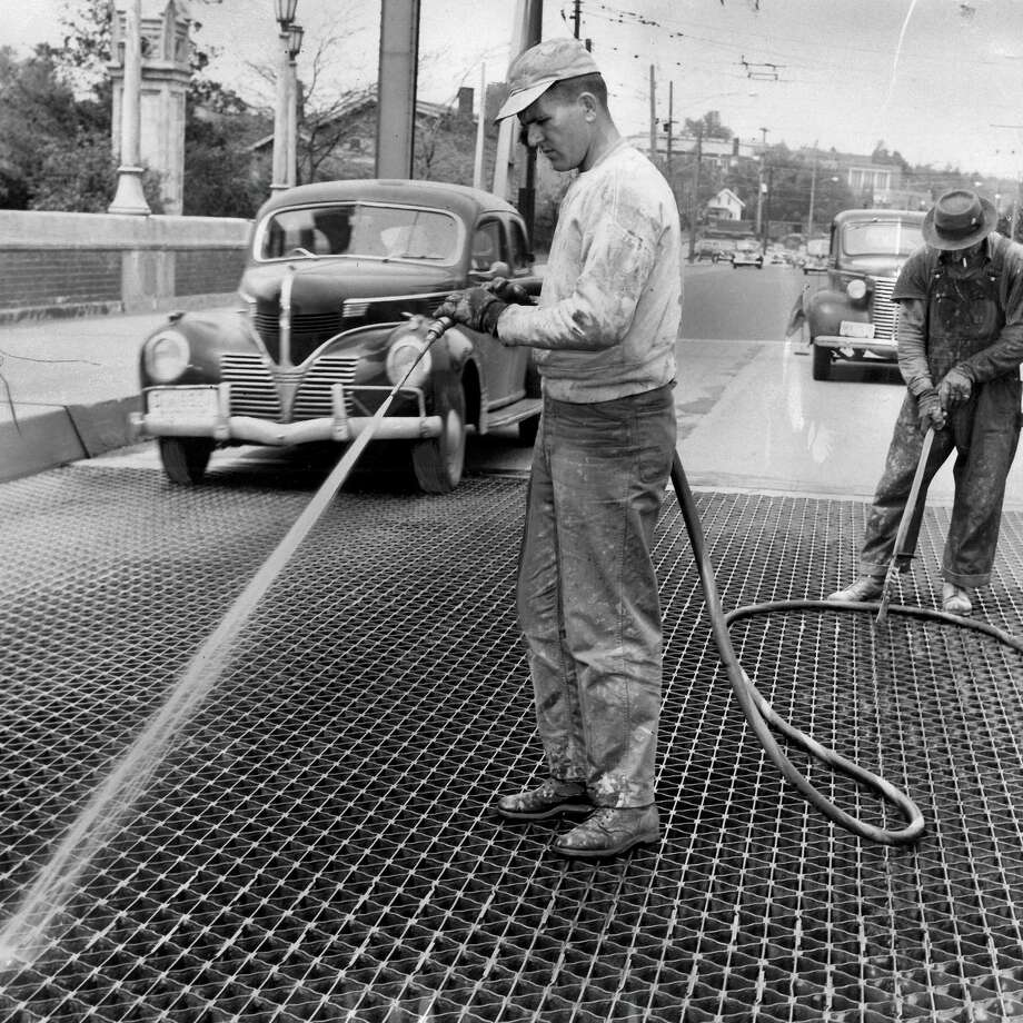 May 27, 1950 - W.L. Connell and John Mansky wash the Montlake Bridge. Photo: FILE PHOTO, SEATTLEPI.COM / SEATTLEPI.COM