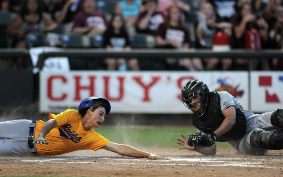 East Bernard senior catcher Justin McGuire, right, tags out Sunnyvale baserunner Brant Taylor in the top of the third inning of their Class 2A UIL State Baseball Championship game at Dell Diamond in Round Rock on Wednesday. Photo: Jerry Baker, For The Chronicle