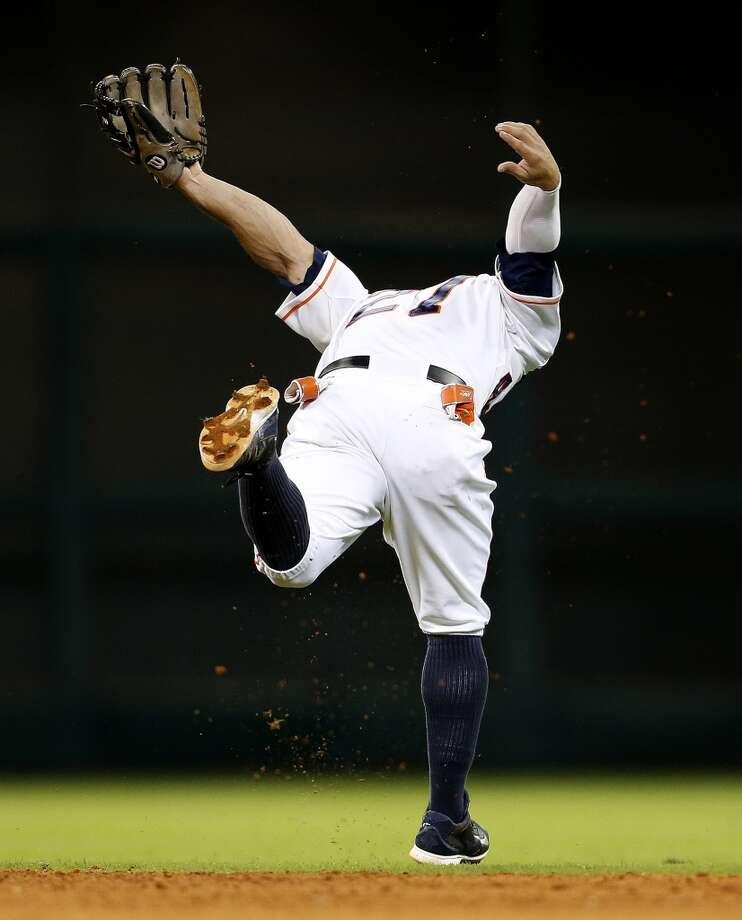 Jose Altuve tries to get a glove on a line drive during the ninth inning. Photo: Karen Warren, Houston Chronicle