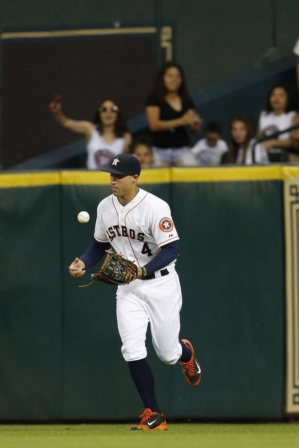 George Springer catches a line drive during the ninth inning. Photo: Karen Warren, Houston Chronicle