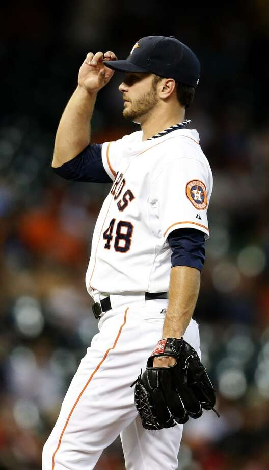 Houston Astros starting pitcher Jarred Cosart (48) touches his cap between pitches in the fourth inning of an MLB baseball game at Minute Maid Park, Wednesday, June 4, 2014, in Houston.  ( Karen Warren / Houston Chronicle  ) Photo: Karen Warren, Houston Chronicle