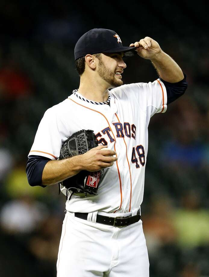 Houston Astros starting pitcher Jarred Cosart (48) touches his cap with his glove hand during the sixth inning of an MLB baseball game at Minute Maid Park, Wednesday, June 4, 2014, in Houston.  ( Karen Warren / Houston Chronicle  ) Photo: Karen Warren, Houston Chronicle