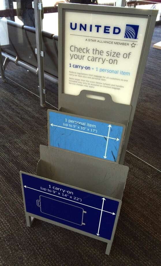 During the past year, United has begun cracking down on passengers attempting to bring clearly oversized luggage on board and, instead of gate-checking the bag, United workers have sent passengers back through security to check a bag (and pay for it) at the check-in counter. Photo: Spud Hilton, Bad Latitude