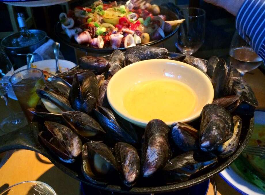 Iron skillet roasted mussels with drawn butter ($16)