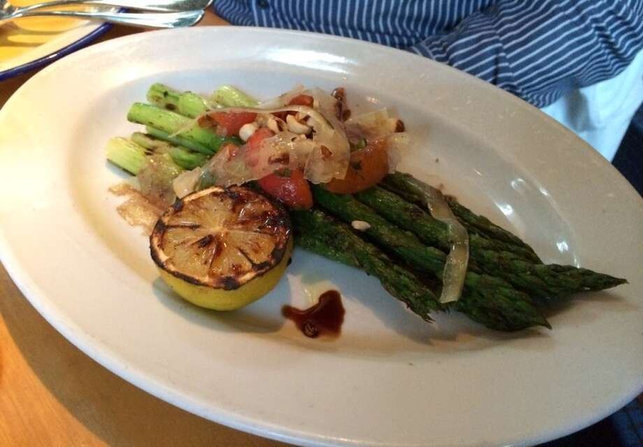 Asparagus roasted in the wood oven with apricots and hazelnuts ($14)