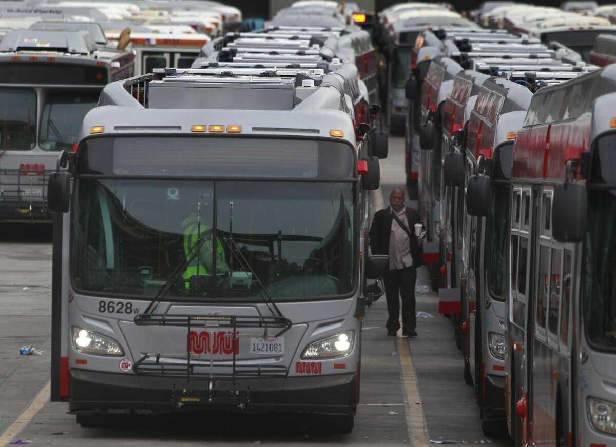 Drivers prepare for their runs at the bus yard at 23rd and Indiana streets on in San Francisco on Wednesday, June 4, 2014. Most workers reported for work today and Muni should be operating at full capacity.