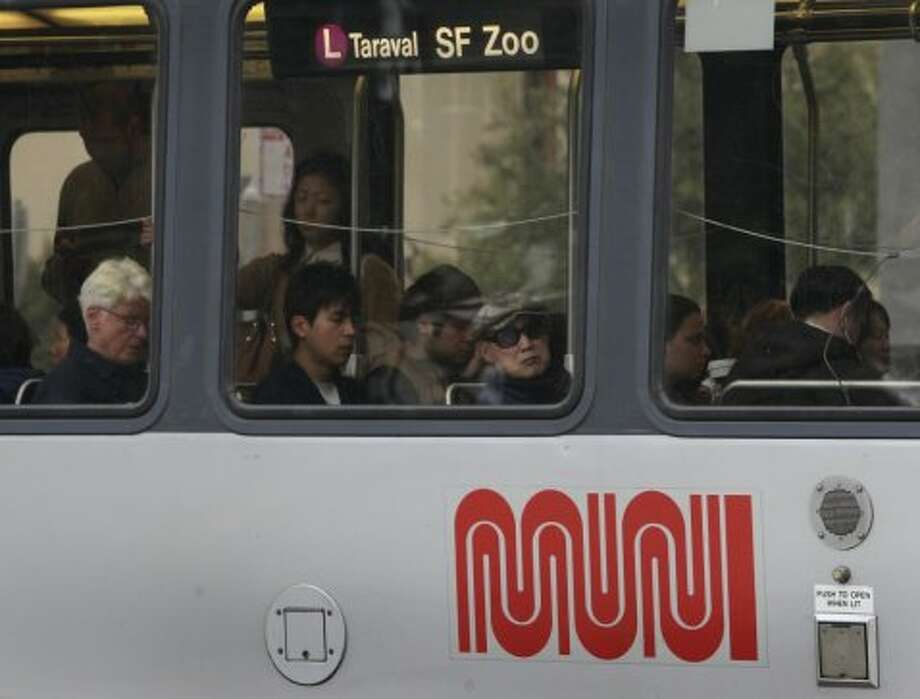 Passengers ride an inbound Metro lightrail streetcar near the West Portal station on the third day of a sickout by Muni employees in San Francisco, Calif. on Wednesday, June 4, 2014. More workers reported for work today, but the system is still not operating at full capacity. The union employees are upset by a contract proposal made by MTA management. Photo: Paul Chinn, The Chronicle
