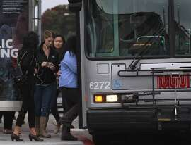 Commuters board a 38-Geary bus at 3rd Avenue and Geary Boulevard on the third day of a sickout by Muni employees in San Francisco, Calif. on Wednesday, June 4, 2014. More workers reported for work today, but the system is still not operating at full capacity. The union employees are upset by a contract proposal made by MTA management.