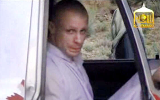 In this image taken from video obtained from Voice Of Jihad Website, which has been authenticated based on its contents and other AP reporting, Sgt. Bowe Bergdahl sits in a vehicle guarded by the Taliban in eastern Afghanistan. The Taliban have released a video showing the handover of Bergdahl to U.S. forces in eastern Afghanistan. The video, emailed to media on Wednesday, shows Bergdahl in traditional Afghan clothing sitting in a pickup truck parked on a hillside. More than a dozen Taliban fighters with machine guns stand around the truck and on the hillside. (AP Photo/Voice Of Jihad Website via AP video) Photo: Uncredited, Associated Press / Voice Of Jihad Website