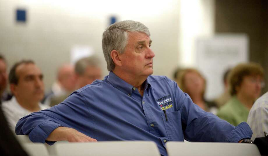 Robert Horton, from Blackstone Industries Inc, in Bethel, listens to a presentation during the Connecticut Department of Labor conference on the state's tax incentives for small businesses, held on Western Connecticut State University, westside campus, in Danbury, Conn, on Thursday, June 5, 2014. Photo: H John Voorhees III / The News-Times Freelance