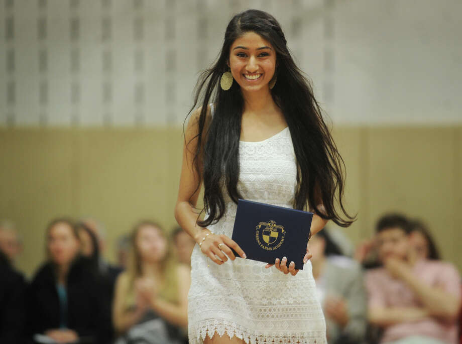 Graduate Priya Gupta of Trumbull walks with her diploma at Greens Farm Academy's Commencement in Westport, Conn. on Thursday, June 5, 2014. Photo: Brian A. Pounds / Connecticut Post