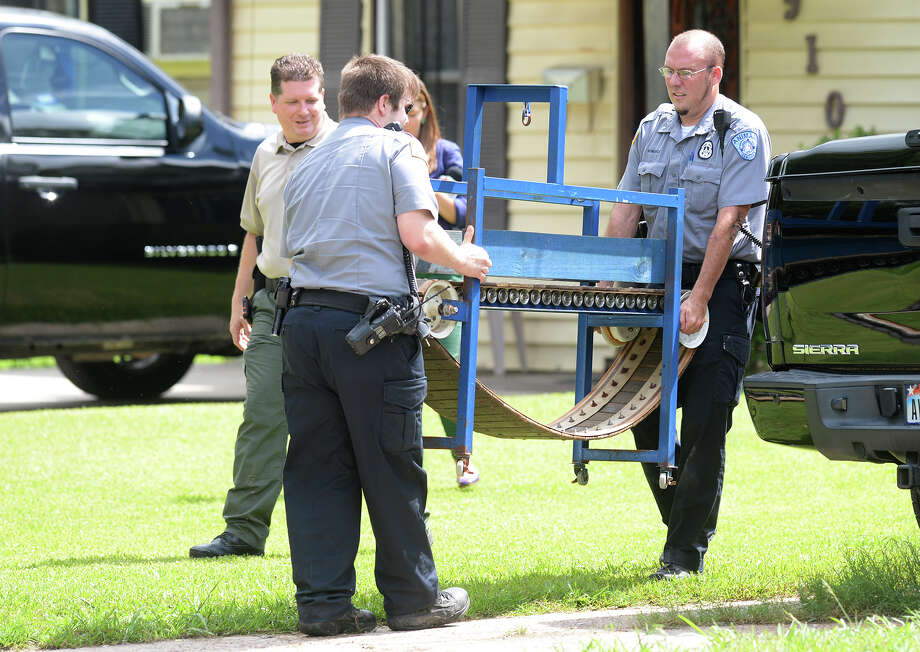 Beaumont's Animal Control removes a treadmill from a home Thursday after a raid involving drugs and possible dog fighting. Thirteen pit bulls, syringes, and other items were also removed from the home on Buffalo Avenue. A man in his mid 20's was arrested by the DEA and is said by BPD's Detective Tina Lewallen to possibly face animal cruelty fighting charges later. Photo taken Thursday, June 06, 2014 Guiseppe Barranco/@spotnewsshooter Photo: Guiseppe Barranco, Photo Editor