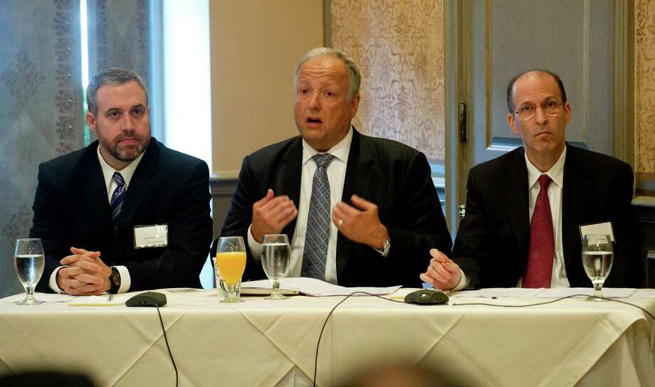 Panelists, from left, John Farnsworth, Seth Cohen and David Moise speak during a breakfast seminar about eggshell audits hosted by law firm Withers Bergman at the Delamar Harbor Hotel in Greenwich, Conn., on Thursday, June 5, 2014. Photo: Lindsay Perry / Stamford Advocate