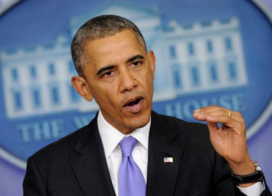 Article: Barack ObamaNo. of revisions: 23,514 Photo: Susan Walsh, STF / AP