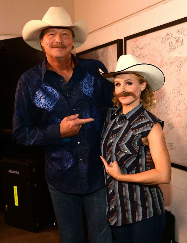 Who looks better in a mustache?Alan Jackson and Kristen Bell point fingers at the CMT Music 