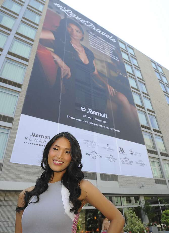 What are the odds?As luck would have it, fashion model Geena Rocero just happens to be standing   under a huge billboard of herself advertising Marriott International #LoveTravels in Washington. Photo: Larry French, Getty Images For Marriott Intern