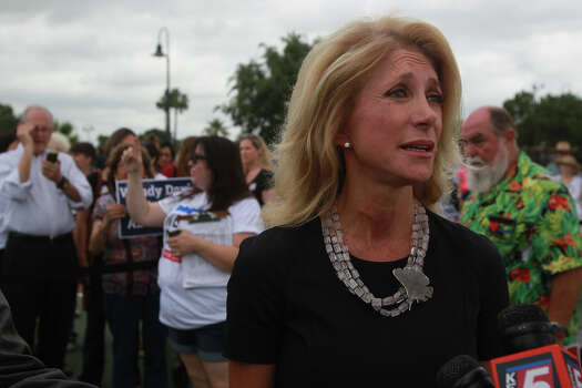 Texas Senator and gubernatorial candidate Wendy Davis speaks with the media Thursday June 5, 2014 at Woodlawn Lake Park. Davis spoke about her Republican opponent and issues like equal pay for women. Davis also showed her support for the San Antonio Spurs. Photo: JOHN DAVENPORT, San Antonio Express-News / ©San Antonio Express-News/John Davenport