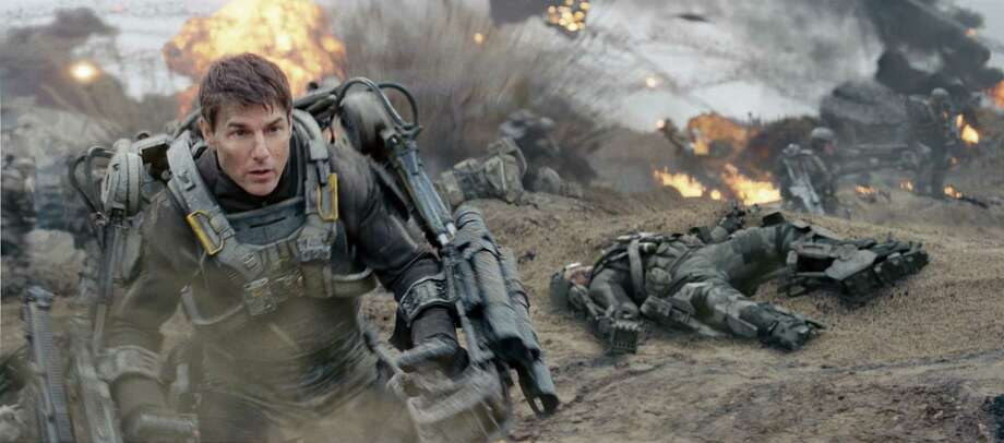 "This image released by Warner Bros. Pictures shows Tom Cruise in a scene from ""Edge of Tomorrow."" (AP Photo/Warner Bros. Pictures) ORG XMIT: NYET180 / Warner Bros. Pictures"