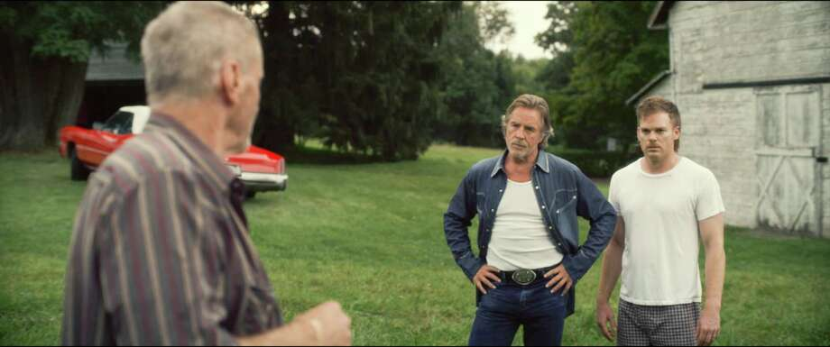 "In an undated handout image, Michael C. Hall, right, Don Johnson and Sam Shepard, left, in the movie ""Cold In July."" After wrapping up a long run on cable television as the star of ""Dexter,"" Hall played the lead in this neo-noir thriller before heading to Broadway for a role in playwright Will Eno's comedy ""The Realistic Joneses."" (Ryan Samul/IFC Films via The New York Times) --  PHOTO MOVED IN ADVANCE AND NOT FOR USE - ONLINE OR IN PRINT - BEFORE APRIL 20, 2014. -- NO SALES; FOR EDITORIAL USE ONLY WITH STORY SLUGGED THEATER-HALL BY WEINERT-KENDT. ALL OTHER USE PROHIBITED ORG XMIT: XNYT48 Photo: FRED R. CONRAD / NYTNS"
