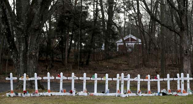Crosses bear the names of the Newtown, Conn., shooting victims in Sandy Hook village. Photo: Seth Wenig, Associated Press