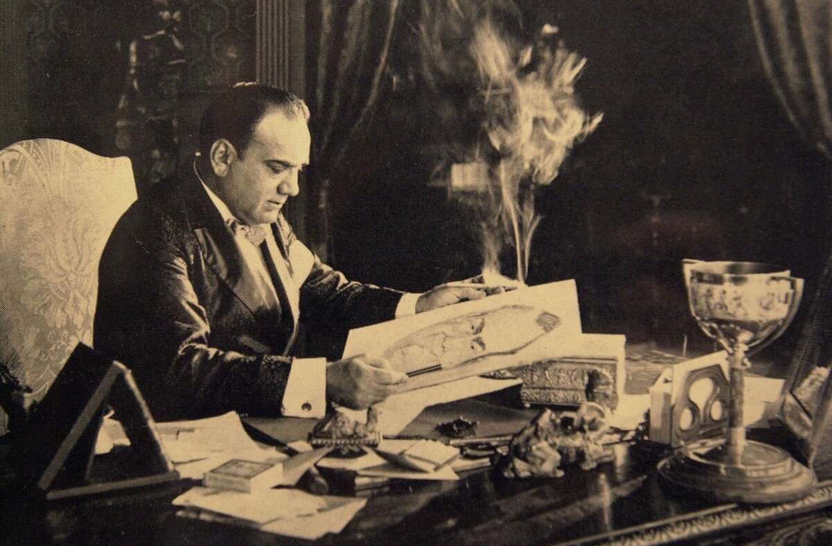 Enrico Caruso sits at a desk behind a ubiquitous cloud of cigarette smoke in this undated photo released by Aldo Mancusi, who has turned his Brooklyn, N.Y., home into a shrine to the great Italian tenor. (AP Photo)