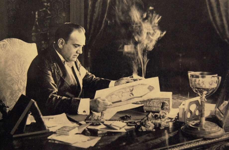 Enrico Caruso sits at a desk behind a ubiquitous cloud of cigarette smoke in this undated photo released by Aldo Mancusi, who has turned his Brooklyn, N.Y., home into a shrine to the great Italian tenor. (AP Photo) Photo: SHN / ENRICO CARUSO MUSEUM