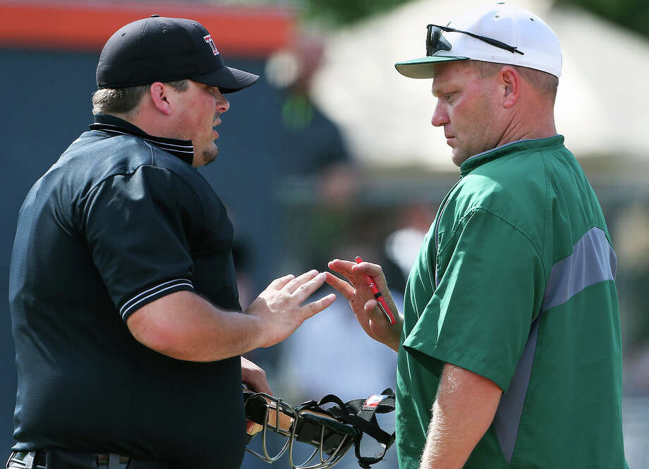 Rattler coach Chans Chapman, right, and Reagan are looking to become the first state titlist within the city limits in UIL's highest classification since Highlands (4A) in 1968. Photo: TOM REEL