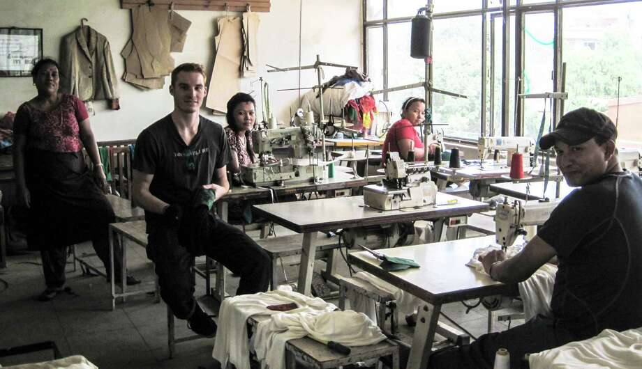 The studio in Nepal where Moutkarma, in partnership with the NGO Folk Nepal, manufactures its clothing and accessories, made from recycled prayer flags. From left to right:  Sakina, Kevin Lanuk, Jotsa, Amita, and Sunil. Photo: Contributed Photo / Stamford Advocate Contributed