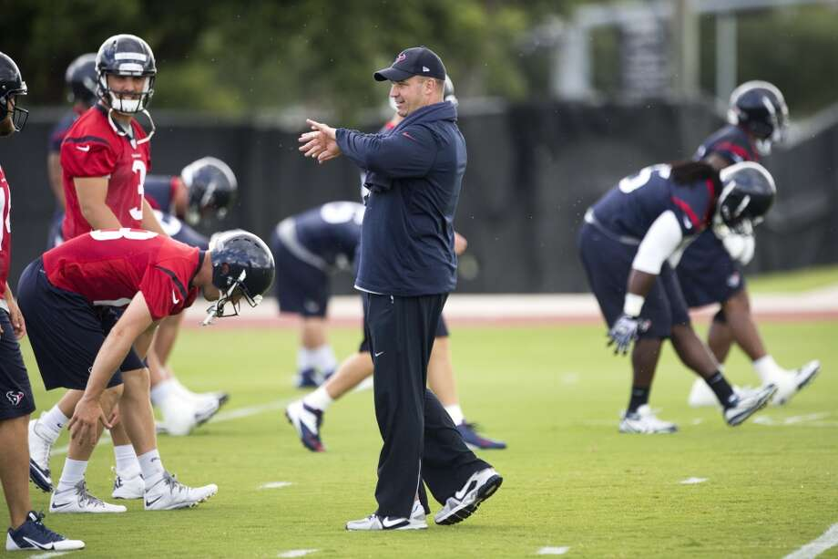 Day 6 - June 5  Head coach Bill O'Brien walks across the field as his players warm up. Photo: Brett Coomer, Houston Chronicle