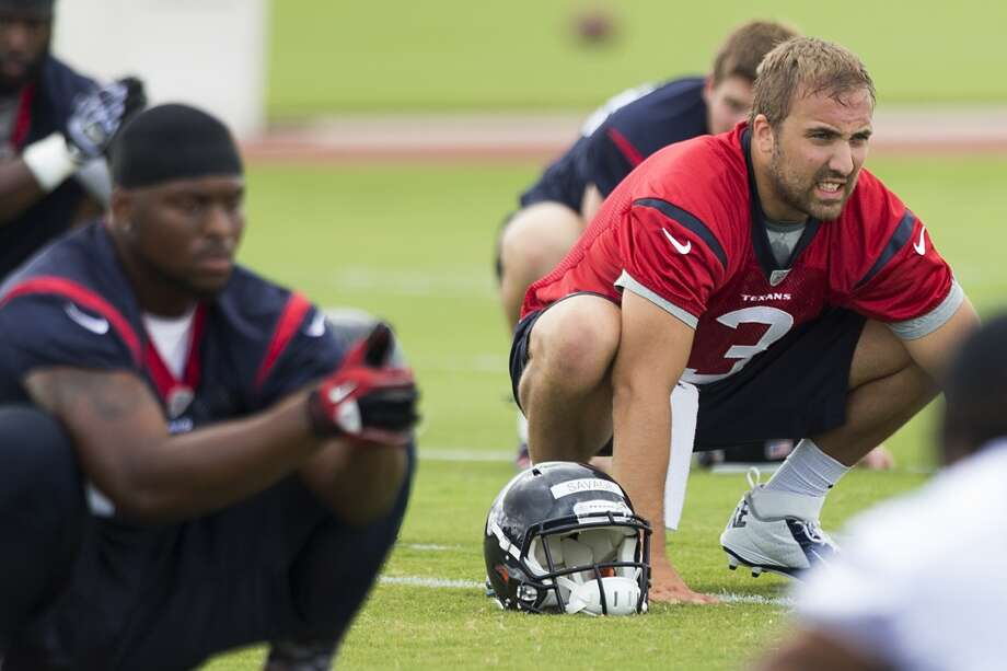 Quarterback Tom Savage (3) stretches at the beginning of practice. Photo: Brett Coomer, Houston Chronicle
