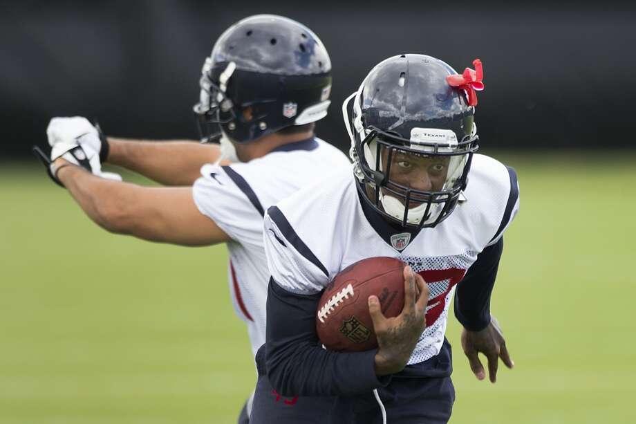 Elbert Mack runs with the ball. Photo: Brett Coomer, Houston Chronicle