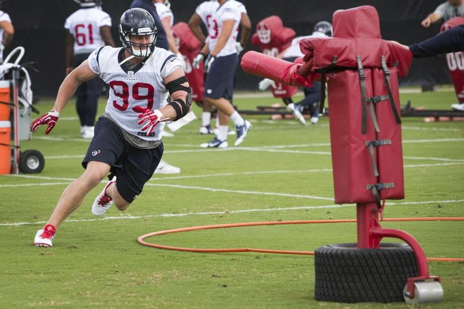 Defensive end J.J. Watt (99) runs through a drill. Photo: Brett Coomer, Houston Chronicle