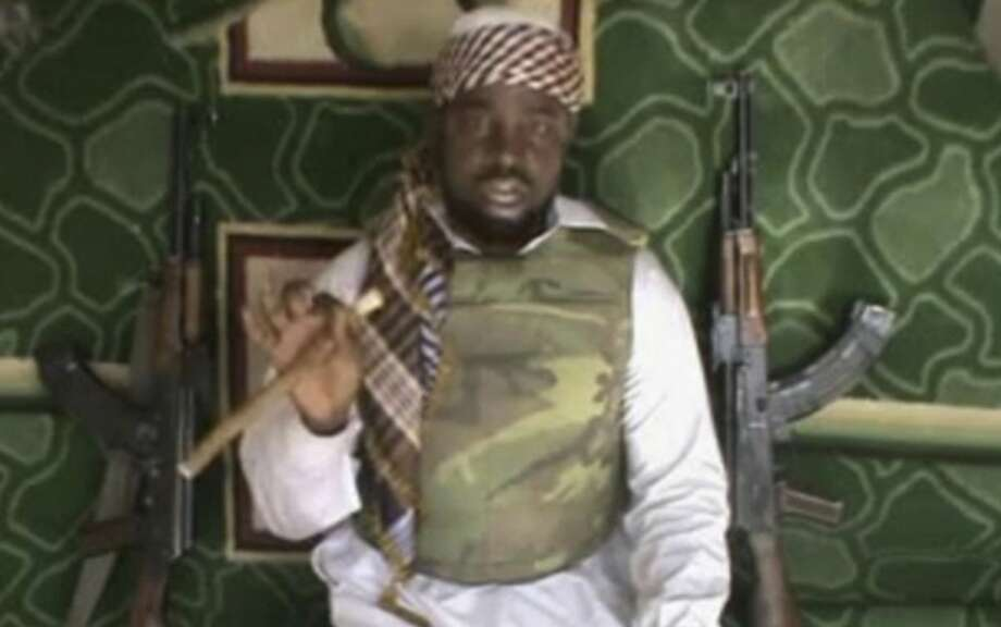 This file image made available from Wednesday, Jan. 10, 2012, taken from video posted by Boko Haram sympathizers shows Imam Abubakar Shekau, the leader of the radical Islamist sect. Boko Haram militants dressed as soldiers slaughtered at least 200 civilians in three villages in northeastern Nigeria and the military failed to intervene even though it was warned that an attack was imminent, witnesses said on Thursday, June 5, 2014. (AP Photo/File) THE ASSOCIATED PRESS CANNOT INDEPENDENTLY VERIFY THE CONTENT, DATE, LOCATION OR AUTHENTICITY OF THIS MATERIAL Photo: Anonymous, Associated Press