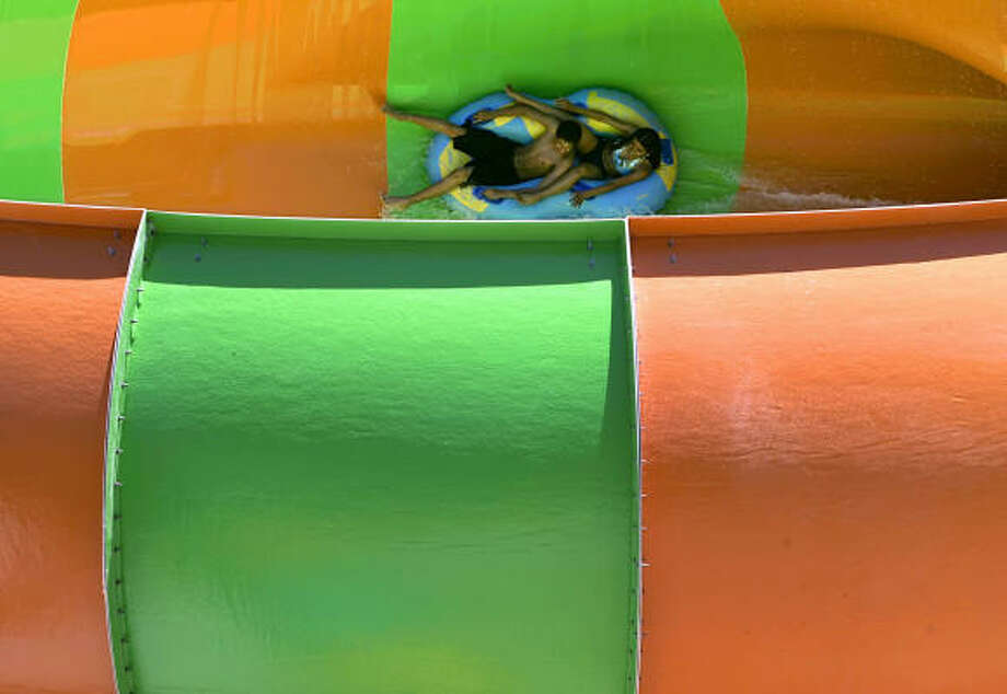 San Antonio attraction:Six Flags Fiesta Texas The kids can ride the Whirlpool, a 40-foot-in-diameter bowl ride, and if you're brave, you can join them. Photo: WILLIAM LUTHER, San Antonio Express-News